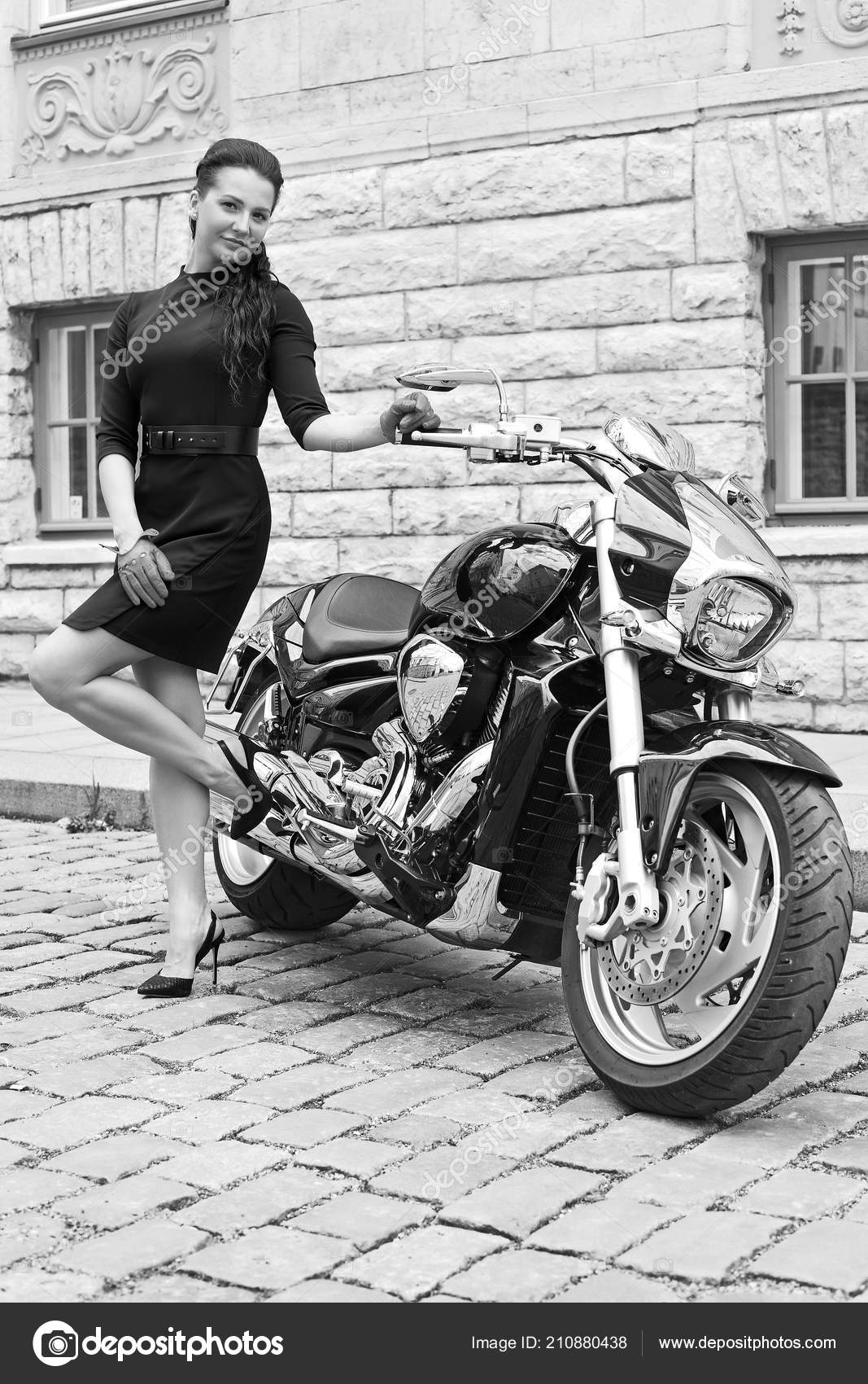 Young girl powerful motorcycle stock photo