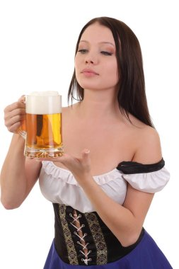 Woman in bavarian dress holding mug of beer