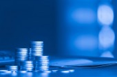 stacks of money coins on blurred background, concept of saving money