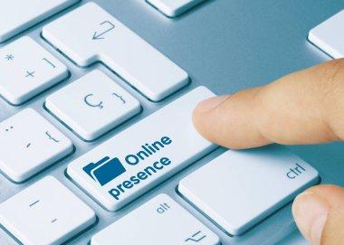 Online presence Written on Blue Key of Metallic Keyboard. Finger pressing key.