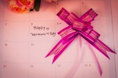 Happy womens day note on calendar book.