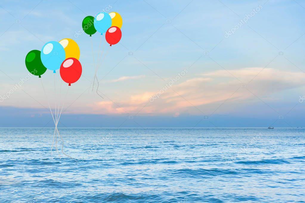 colorful balloon over sea with sun ray background.