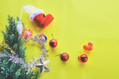 Christmas decoration. Santa's boot,red ball, fir tree branches with