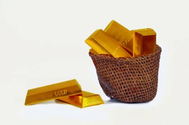 Heap of gold bars in wood basket ,Banking concept.