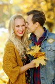 Photo of young man and woman on walk in autumn forest