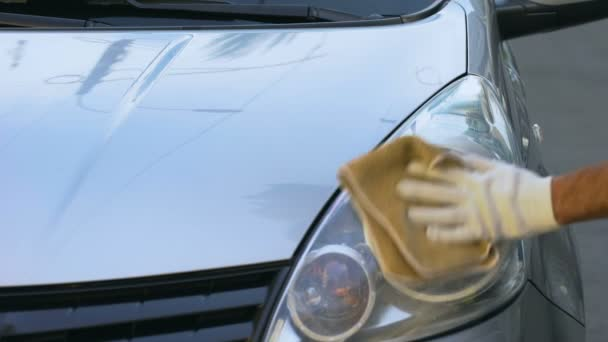 Man Cleaning Headlights On Auto Part Time Job For Students Car