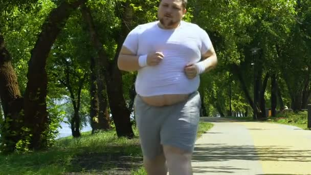 Obese Man Running Outdoors Working Hard Achieve Result Overweight Program Stock Video C Motortion 218291080