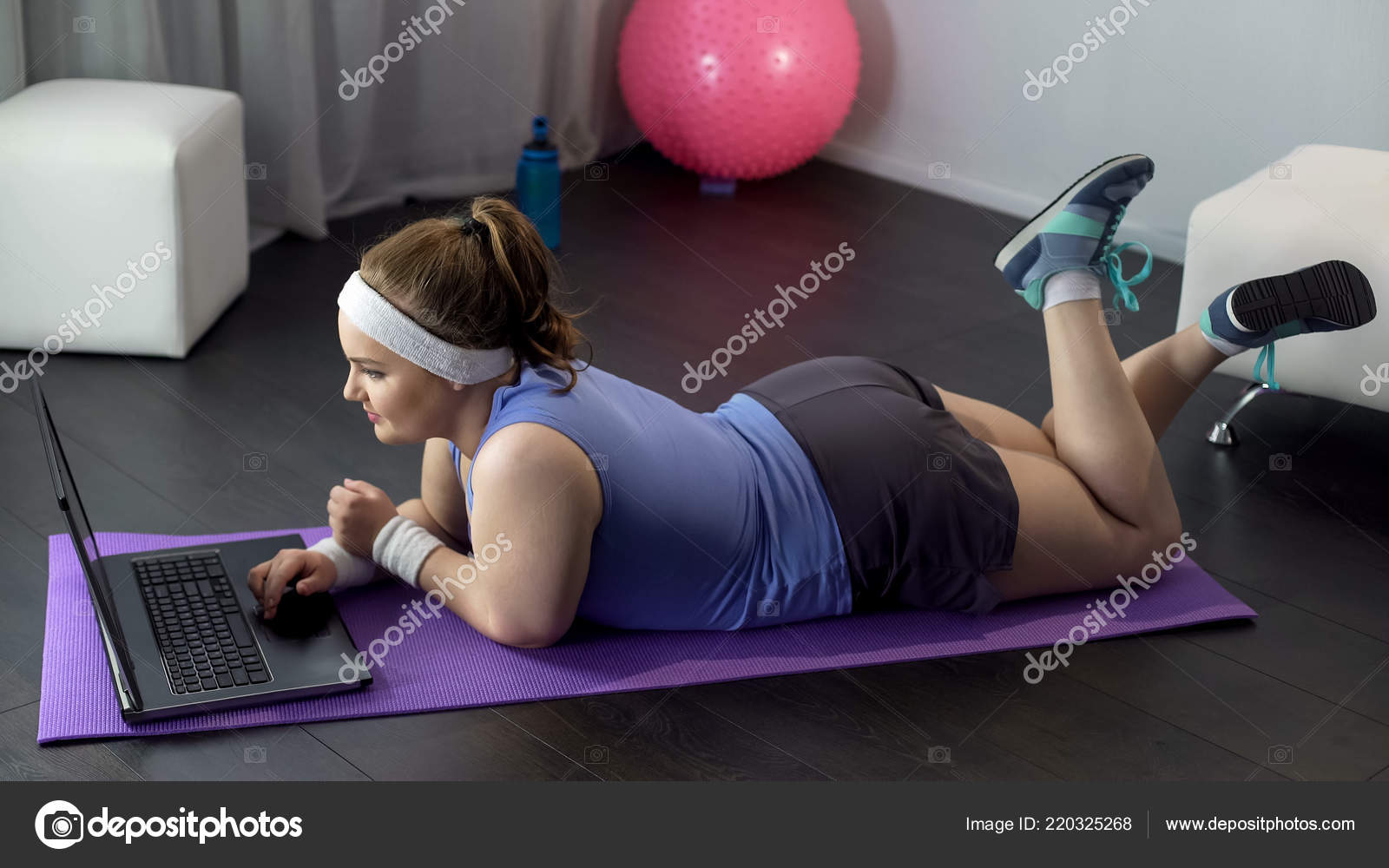 Overweight female delighted see positive dynamics her home workout