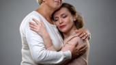 Senior lady hugging adult daughter, parenthood feeling, family understanding