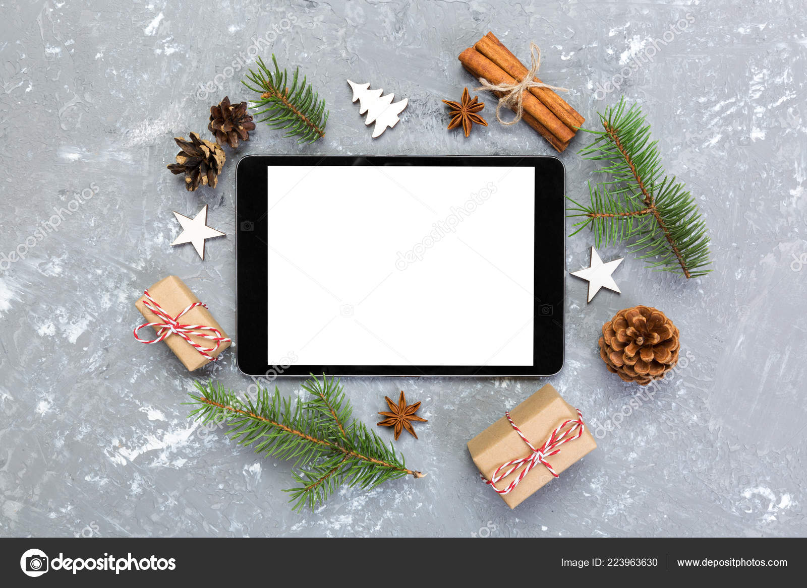 digital tablet mock rustic christmas gray cement background decorations app stock photo - Christmas Digital Decorations