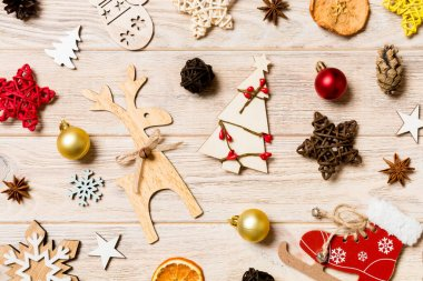 Top view of Christmas toys on wooden background. New Year ornament. Holiday concept.