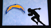 Los Angeles Chargers. Silhouette of professional american football player. Logo of NFL club in background, edit space.