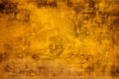 Grunge yellow painted wall texture background.