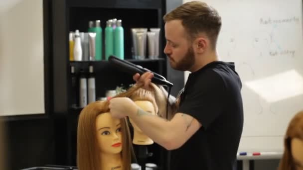 WARSAW, POLAND - March 24, 2019: Hairdressers work with mannequin while studying