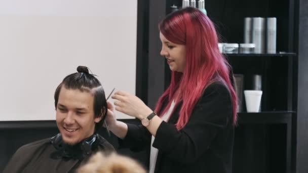 WARSAW, POLAND - June 9, 2019: Professional hairdresser teaching mens cut in hair academy