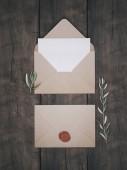 Envelope with an elegant wedding invitation. Place card mockup.
