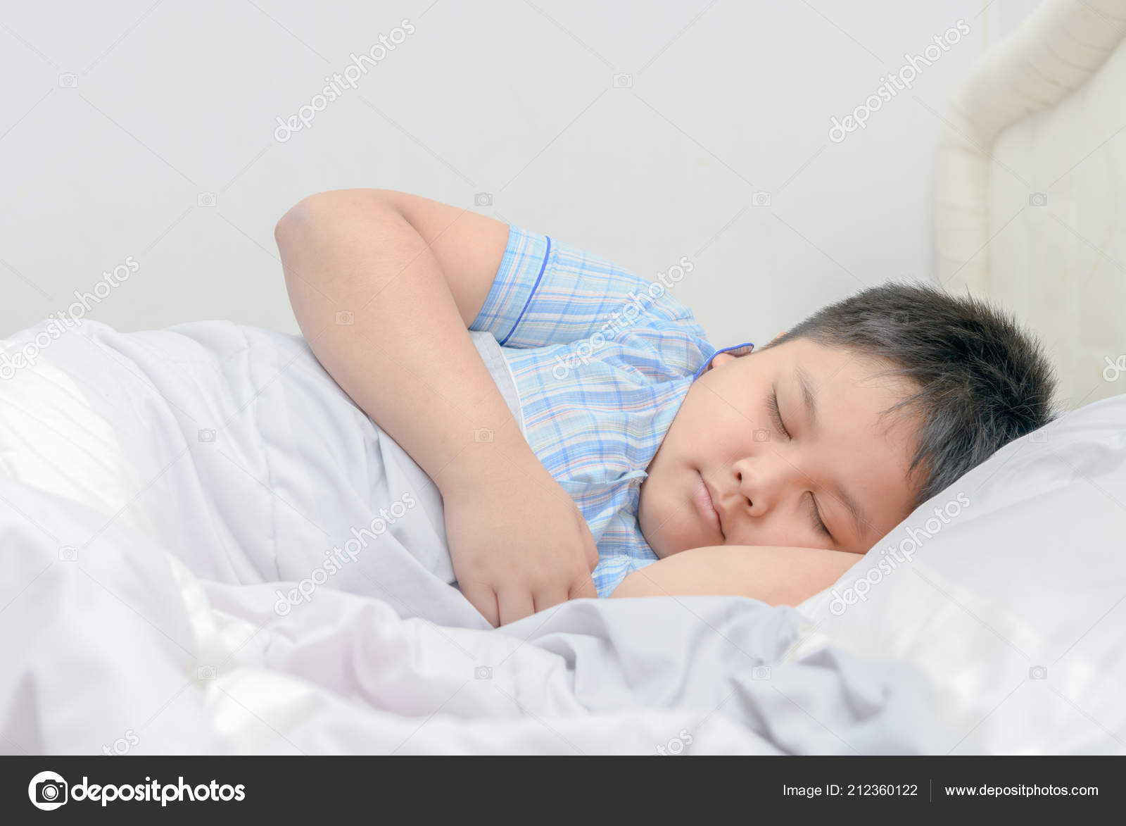 Obese fat boy sleeping bed relaxation concept stock photo