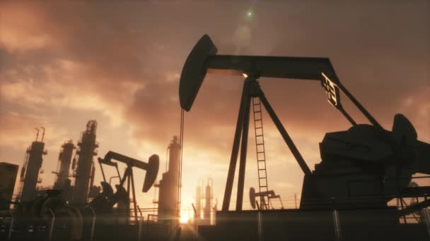 Silhouette of working oil pump jack at sunset. The oil pump, industrial equipment, Loopable animation