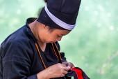 Tkající Buyei ženy