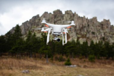 Quadcopter drone outdoors in the sky