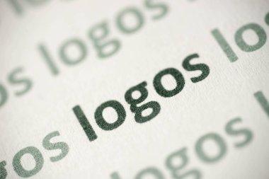 word logos printed on white paper macro