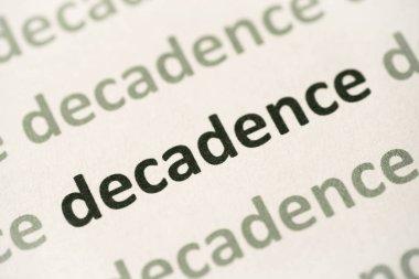 word decadence printed on white paper macro