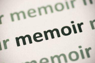 word memoir  printed on white paper macro