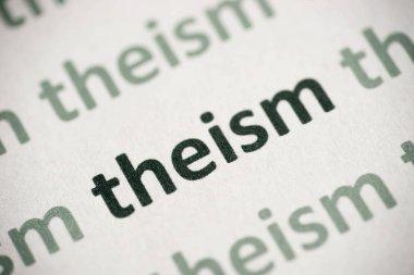 word theism printed on white paper macro