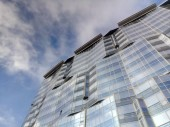 sky reflection in a glass building
