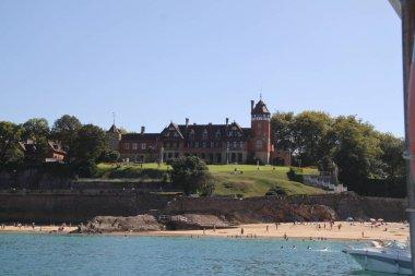Donostia San Sebastian, Pais Vasco, August, 25, 2020: landscape of the Miramar palace from the Bay of San Sebastian