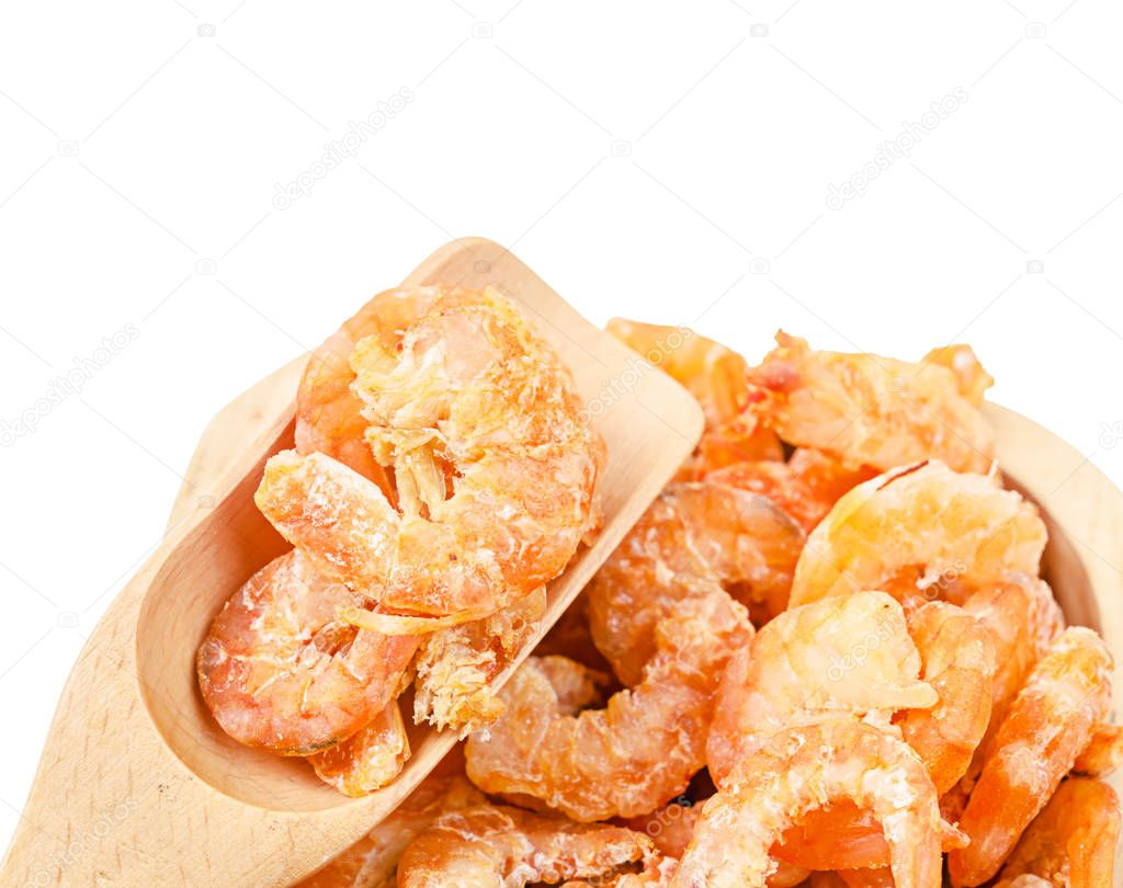 Dried shrimp on wooden ladle isolated on white; background.