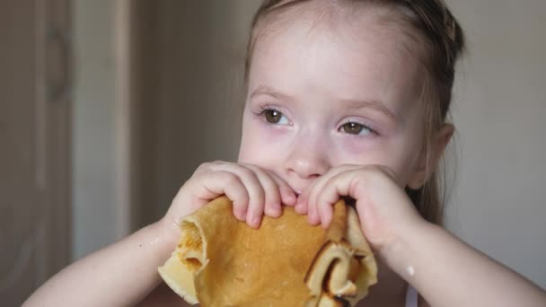 Little girl eats delicious pancakes. Healthy eating for children. Breakfast kid