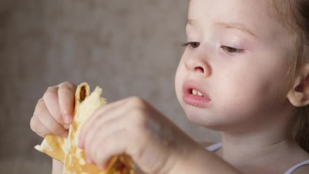 A small child eats delicious pancakes. Healthy eating for children. Breakfast kid. Close-up