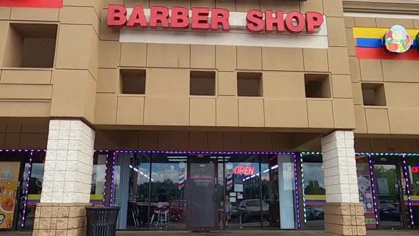 Urban barber shop with child in the window