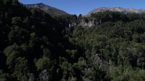 Aerial drone Scene of mountains Piedra Mala, Paimun lake, Neuquen, Patagonia, Argentina, National Park Lanin, sunny day in summer. Cars parking. Camera moving forward and up.
