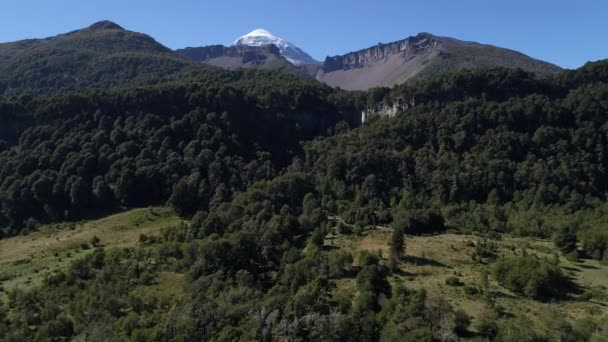 Aerial drone Scene of mountains, trees, El Saltillo cascade and Lanin volcano, Neuquen, Patagonia, Argentina, National Park Lanin, sunny day in summer. Camera moving forward and up