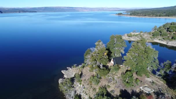 Aerial drone scene of abandoned house on the coast of Alumine lake. Camera moving around abandoned construction in the woods.  Mountains. Touristic area of five lagoons. Mapuche zone.