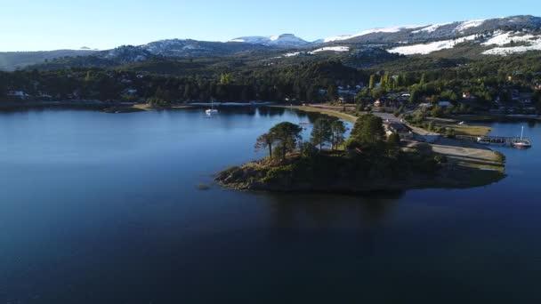 Aerial drone scene of Villa Pehuenia, Moquehue, Neuquen, Patagonia Argentina. Camera turning around peninsula with araucaria . Alumine lake. Batea Mahuida volcano