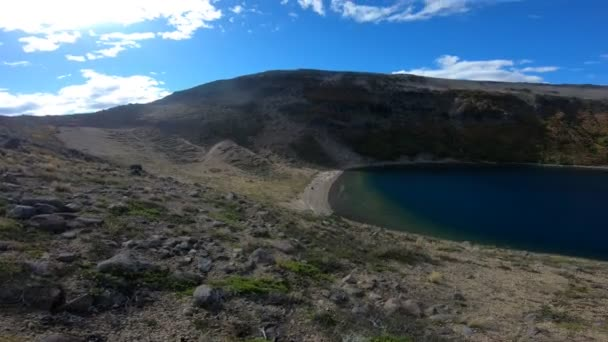 Stabilized camera movement panning right to a lagoon in Batea Mahuida volcanos crater at Villa Pehuenia, Moquehue, Neuquen, Patagonia Argentina. Big Mountain with steppe landscape.