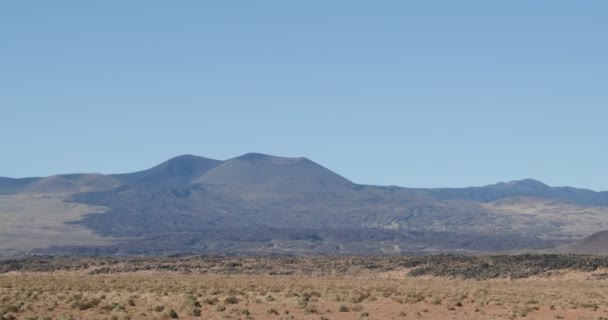 Old volcano in La Payunia National Park in Mendoza, Cuyo Argentina. Bed of lava from mountain.