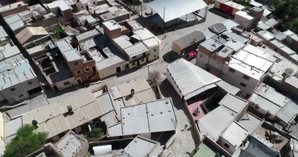 Top aerial drone scene of town with detail of roofs and city streets structure. Iruya, Salta, Argentina