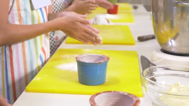 Master class on cooking. Children prepare meals with a professional chef in the kitchen. 4K.