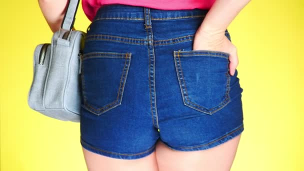 Girl in denim shorts with fashion accessories. denim reticule. Summer fresh style