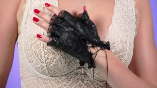 4k. Close-up. Slow motion. A woman with a big chest caresses her breast with her gloved hand