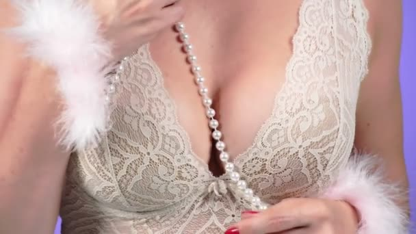 Topless beauty woman body covering her breast. 4k. Close-up. Slow motion. A woman with a big chest caresses her breast. handcuffed. bdsm