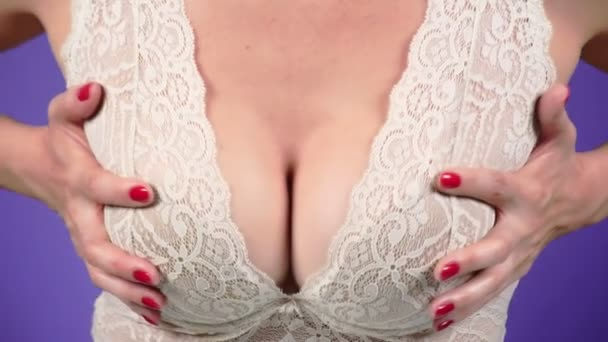 Topless beauty woman body covering her breast. close-up. 4k, slow motion.