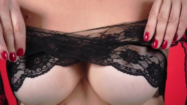 Topless beauty woman body covering her breast. 4k. Close-up. Slow motion. A woman with big breasts caresses her breasts. black lace.