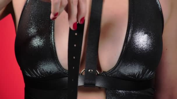 Topless beauty woman body covering her breast. 4k. Close-up. Slow motion. A woman with big breasts caresses her breasts. gag. bdsm