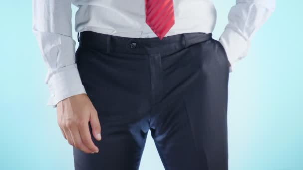 a person has problems with the genitourinary system. businessman on a colored background. 4k, close-up, slow-motion shooting.