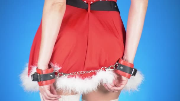 seductive santa girl with sex toys in seductive poses. on a blue background. a close-up. Slow motion. 4k